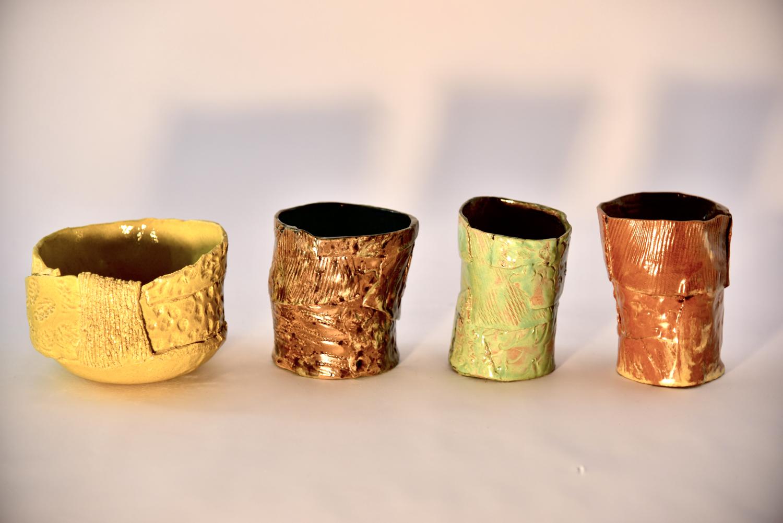 Quattro lavorazioni in ceramica dalle differenti forme e colori
